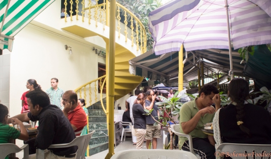 The crowds thronging the outdoor seating area awaiting their turn at the delicious food
